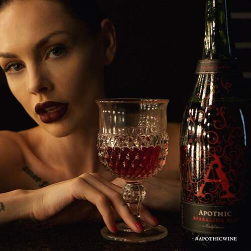 Woman enjoying a glass of Apothic Sparkling Red
